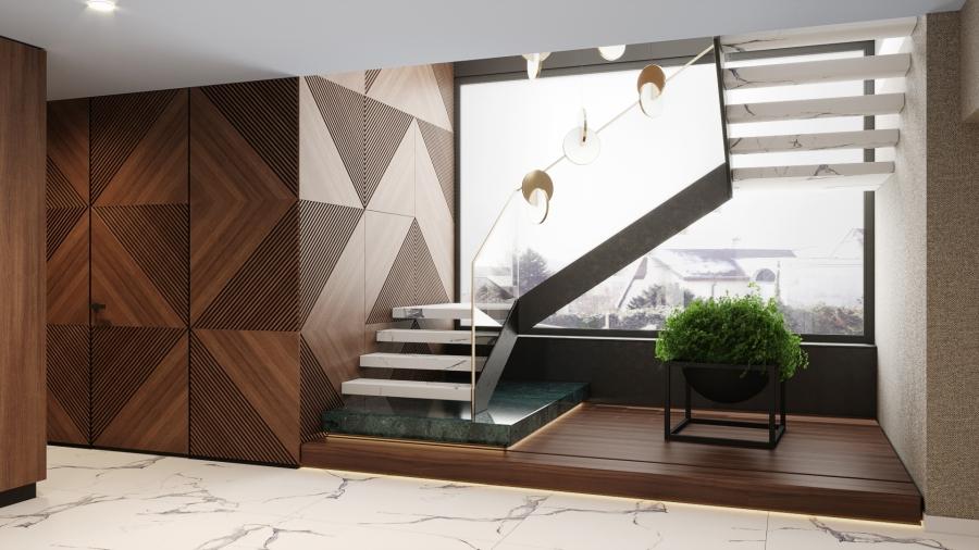 Az emeletre vezető impozáns lebegő lépcső falburkolat mögött gardróbhelyiség található